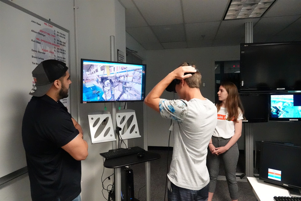Students go for a digital swim with the NBL's virtual reality simulator.