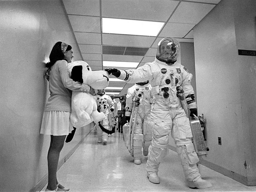 Headed for the launch pad, Apollo 10 Commander Tom Stafford pats the nose of a stuffed Snoopy held by Jamye Flowers (Coplin), astronaut Gordon Cooper's secretary. Image Credit: NASA