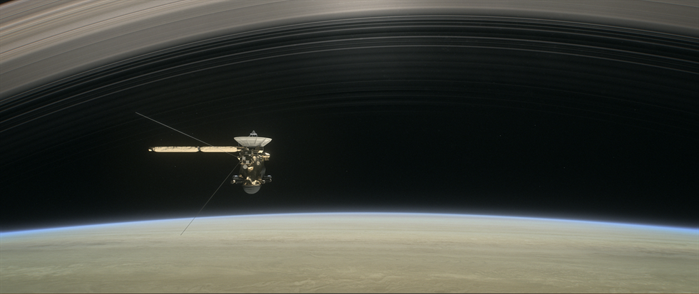 This artist's rendering shows Cassini as the spacecraft makes one of its final five dives through Saturn's upper atmosphere in August and September 2017.