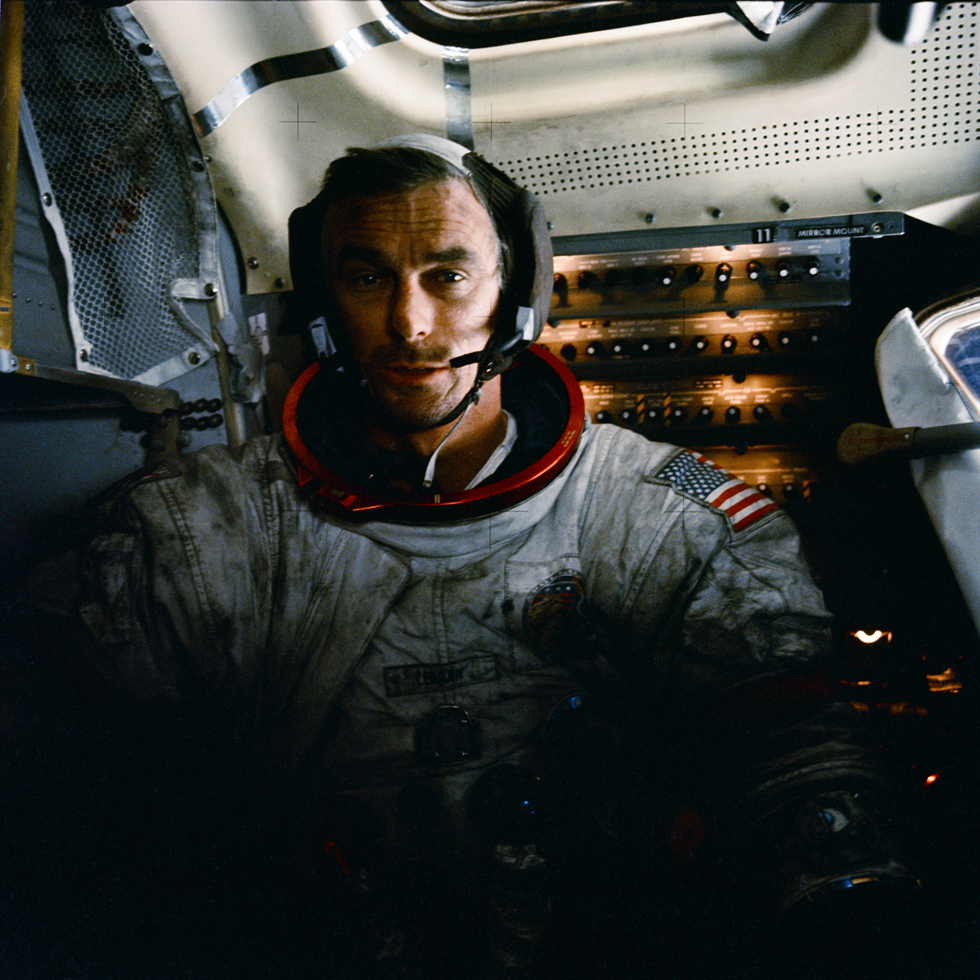 Apollo 17 mission commander Eugene Cernan inside the lunar module on the moon after his second moonwalk of the mission. His spacesuit is covered with lunar dust.