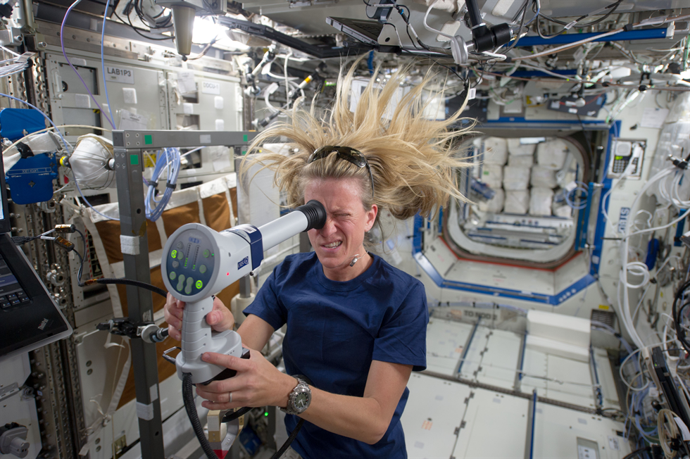 Visual Impairment Intracranial Pressure Syndrome was identified in 2005 and is currently NASA's leading spaceflight-related health risk. Here, NASA astronaut Karen Nyberg of NASA uses a fundoscope to image her eye while aboard the space station. Image Credit: NASA