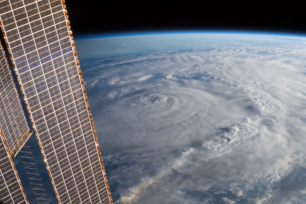View of Hurricane Harvey (possibly over Texas) taken by the Expedition 52 crew aboard the International Space Station. Part of a solar array is also visible. Image Credit: NASA