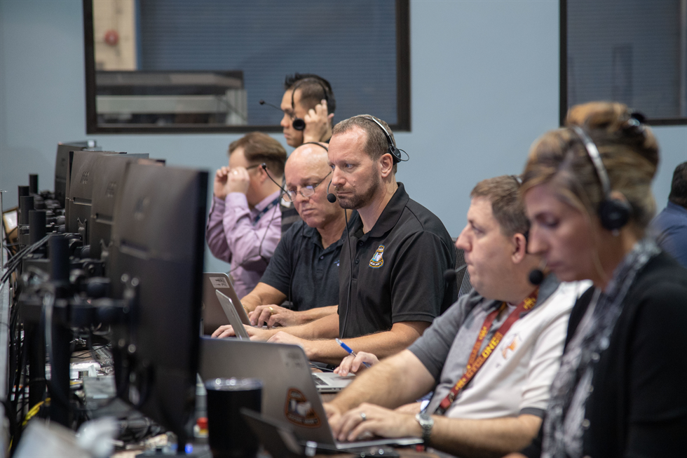 Dr. Jon Olansen (center) trains as a flight controller for the AA-2 launch scheduled for spring 2019.