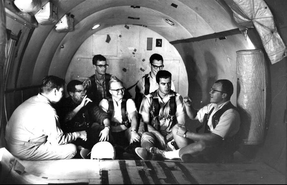 Study participants chat in the zero-g aircraft that flew out of Naval Air Station in Pensacola, Florida.