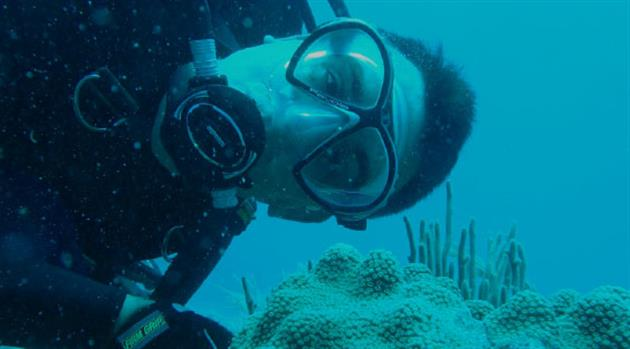 ARES planetary scientist dons flippers and scuba gear for an underwater adventure