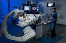 A lone spacesuit proves to be a model patient for a CT-imaging collaboration