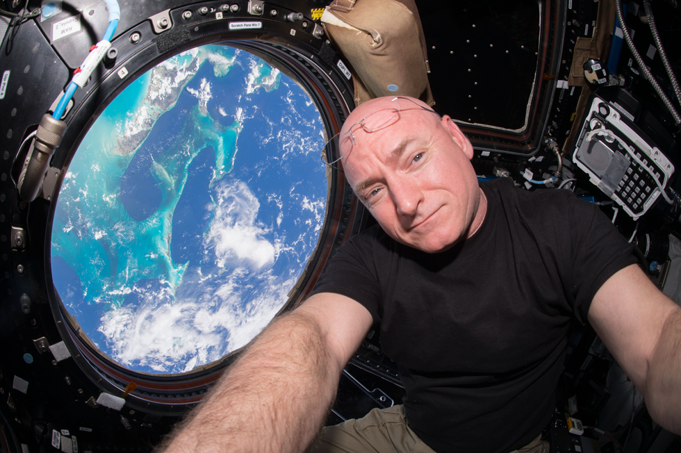 Kelly pauses his Earthgazing out of the Cupola Module Image Credit NASA