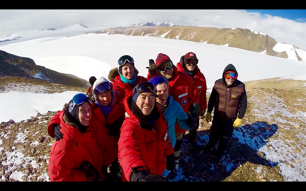 ANSMET team selfie from the North Miller Range, Antarctica. The team, from left: Ellen Crapster-Pregont, Cindy Evans, Nina Lanza, Constantine Tsang, Morgen Martinez, Jim Karner, Brian Rougeux and John Schutt had just finished a long day of hunting meteorites on the blue ice fields. Image Credit: NASA