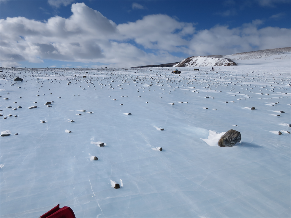 Blue ice field in the Miller Range, near the edge of a moraine. Moraines are piles of rocks deposited along the edge of a glacier. Often they are good hunting grounds for meteorites, but the samples from space are mixed in with lots of terrestrial rocks. Image Credit: NASA/Cindy Evans