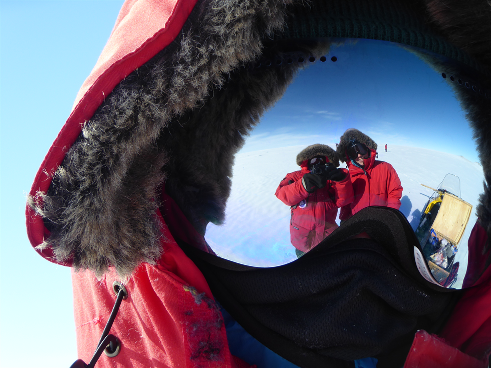 A field selfie using the reflection in Crapster-Pregont's shiny ski goggles. Image Credit: NASA/Cindy Evans