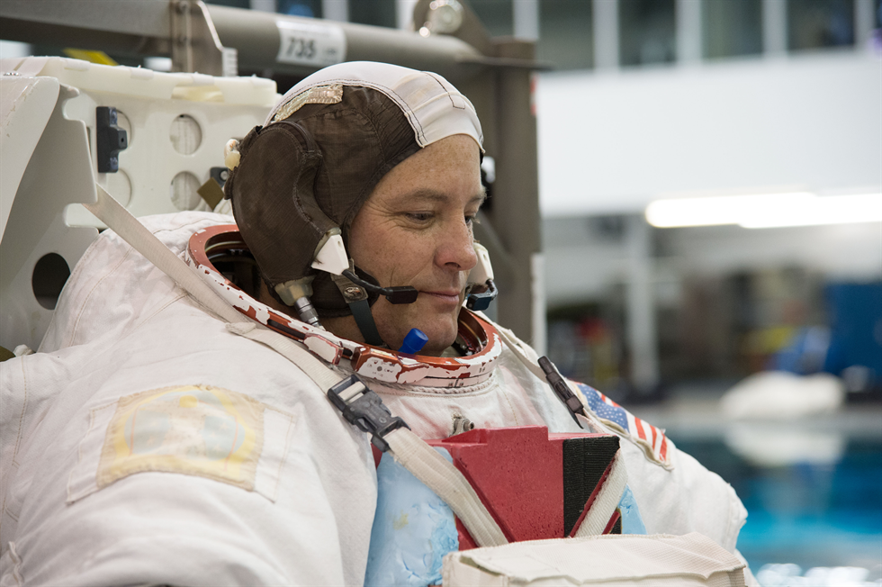 NASA astronaut Scott Tingle awaits the start of a spacewalk training session in the waters of the Neutral Buoyancy Laboratory at Johnson Space Center in Houston. Image Credit: NASA
