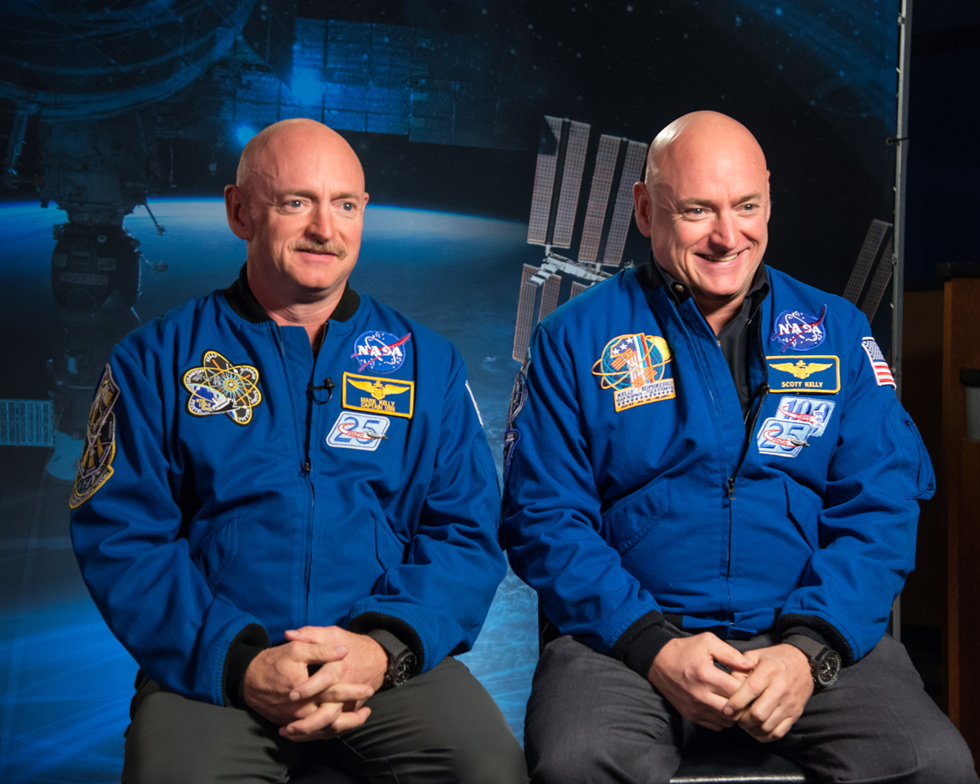 Expedition 45/46 commander and retired astronaut Scott Kelly (right), along with his twin brother, retired astronaut Mark Kelly (left), speak to media about the Twins Study and one-year mission. Image Credit: NASA