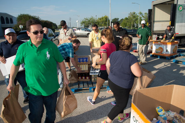 Community members picking up supplies such as food and water at a local donation center