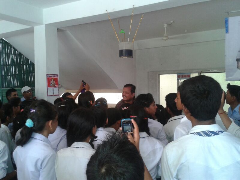Students swarm the exhibit to learn about former astronaut Neil Armstrong and the science gleaned from lunar sample studies. Image Credit: Everest Science Center, Nepal