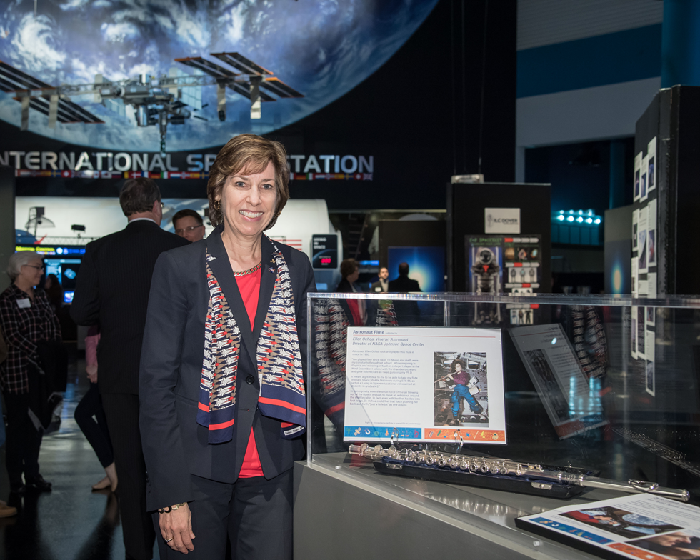 JSC Director Ellen Ochoa poses with her flute, showing her own artistic bent. Image Credit: NASA/Bill Stafford