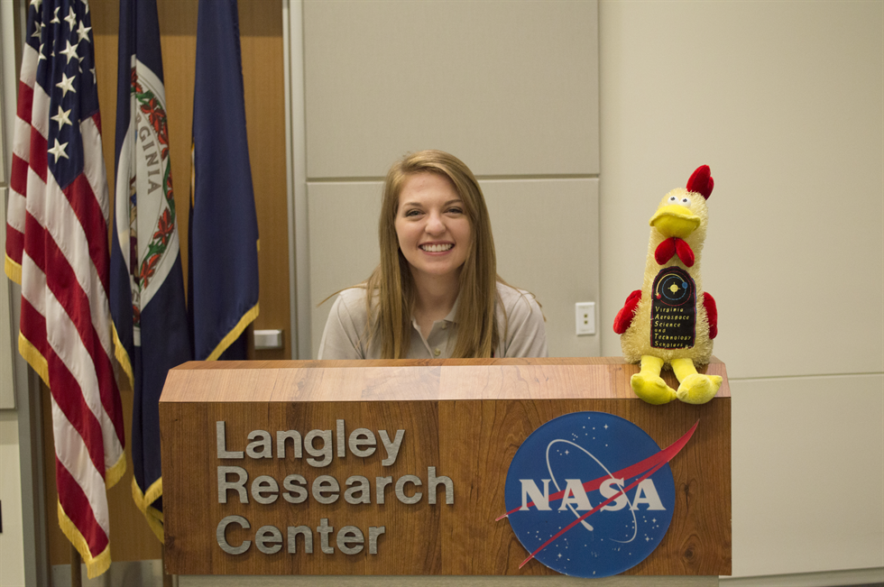 NASA intern Brooke Nelson stands behind a podium at Langley Research Center. Image courtesy of Brooke Nelson.
