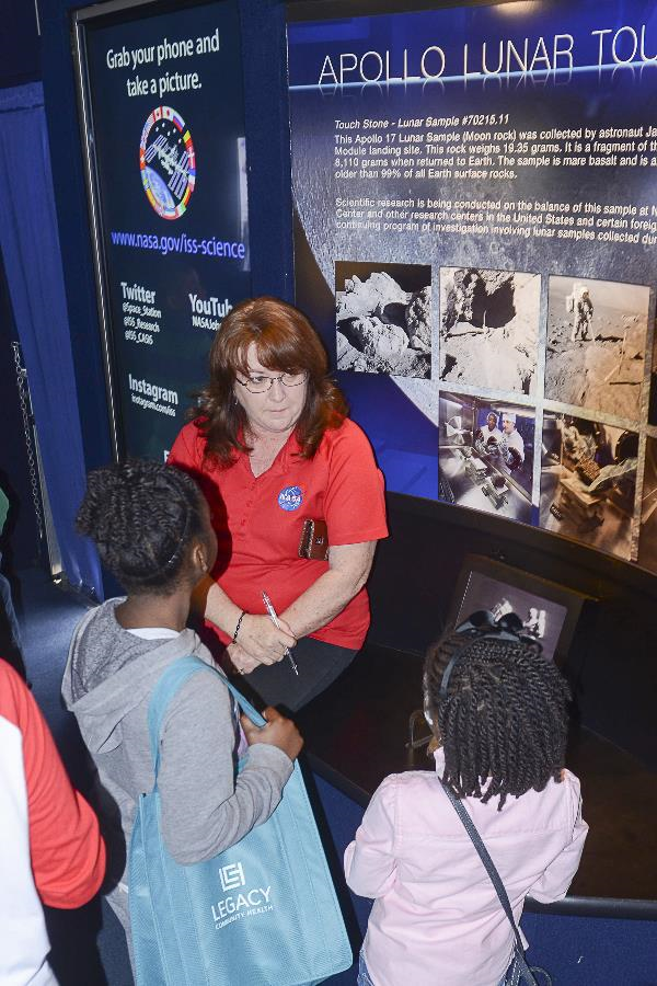 Houston's youngest citizens learn about human space exploration from Janet Stewart with Johnson's Office of Communications and Public Affairs at the Driven to Explore mobile exhibit. Image courtesy of the Port City Chapter of The Links, Inc.