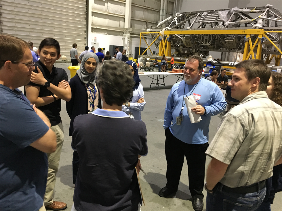 Interns and the Safety and Mission Assurance team break up into small groups to discuss their takeaways from the movie. Image Credit: NASA