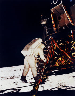 Buzz Aldrin climbs down the Eagle's ladder to the surface. Image Credit: NASA