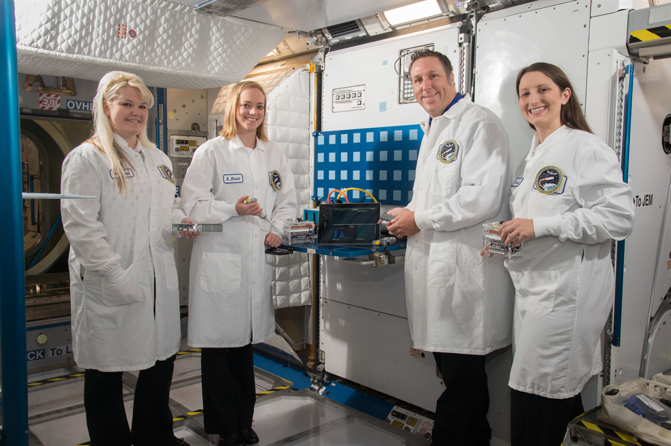 From left, Sarah Wallace, Sarah Stahl, Aaron Burton and Kristen John, project developers for the Biomolecule Sequencer located at NASA's Johnson Space Center in Houston. Image Credit: NASA