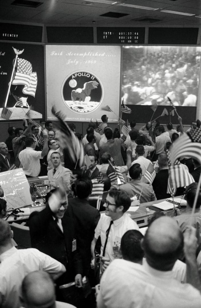 Flight controllers celebrate the successful conclusion of the Apollo 11 lunar landing mission on July 24, 1969, in NASA's Mission Control Center in Houston. Image Credit: NASA
