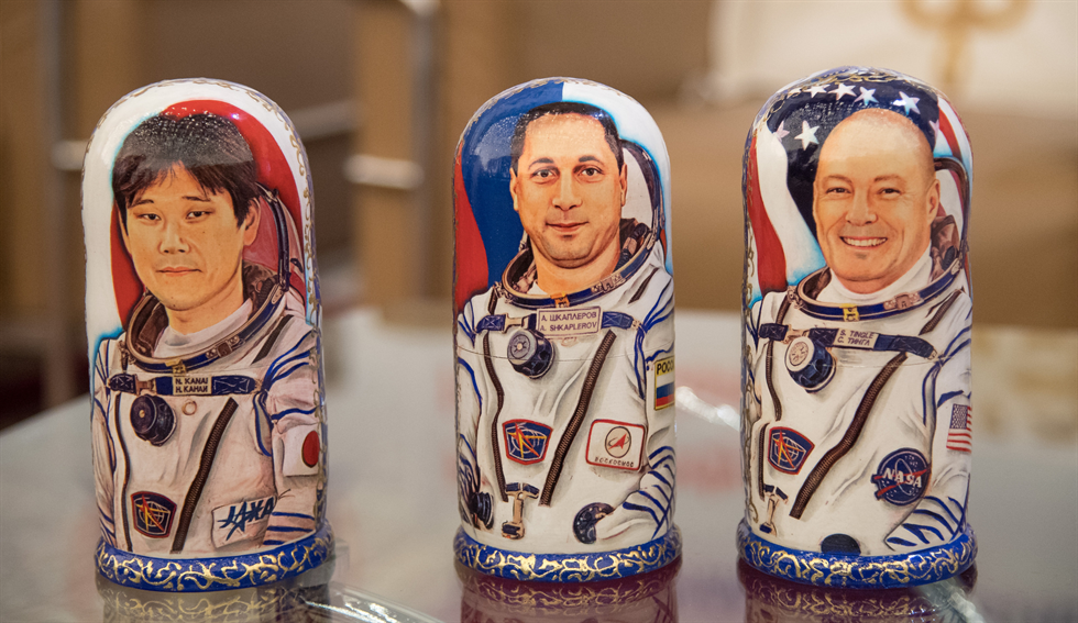 Matryoshka Dolls representing Expedition 55 crew members Kanai, left, Shkaplerov, center, and Tingle are seen at a Karaganda Airport welcome ceremony in Kazakhstan. Image Credit: NASA/Bill Ingalls