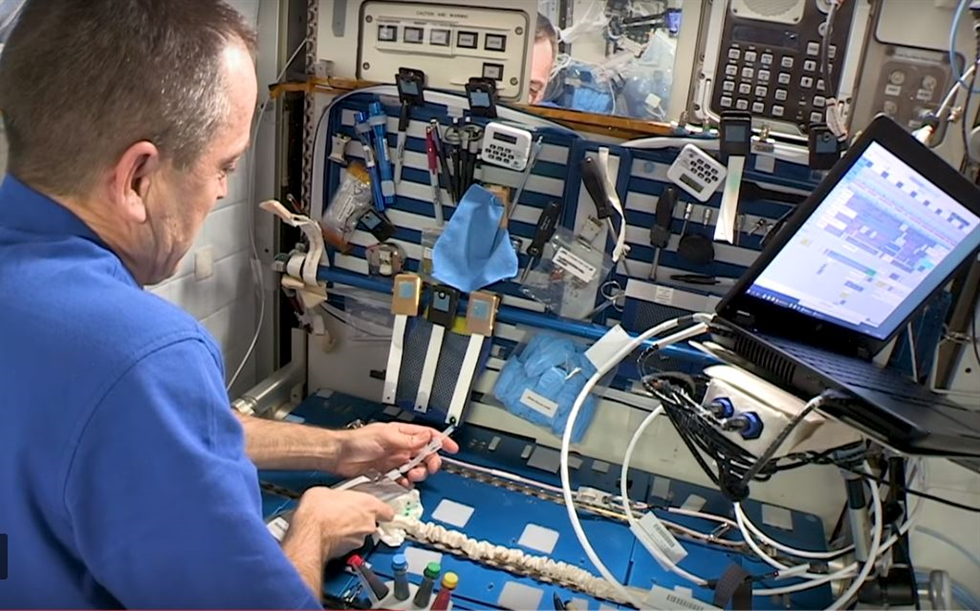 NASA Astronaut Ricky Arnold completing the first of Christa's Lost Lessons. Credit: NASA