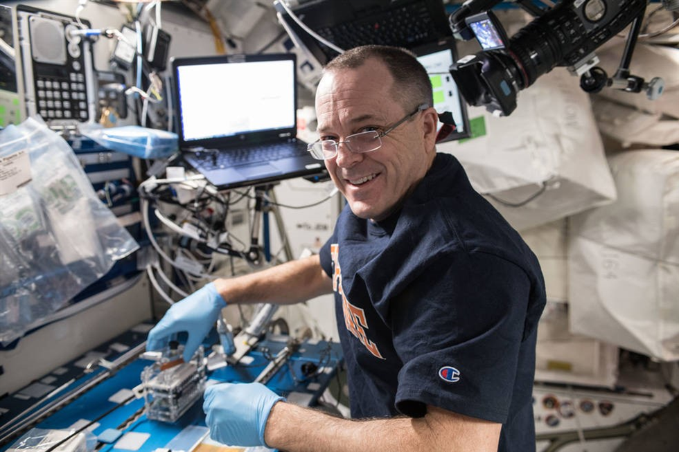 Ricky Arnold completing science on the International Space Station. Credit: NASA