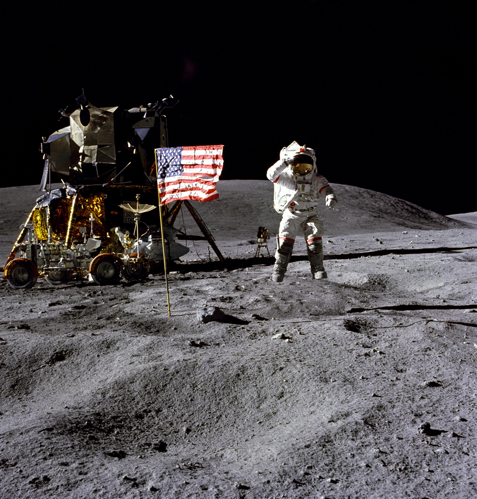 John Young on the Moon, with the Lunar Module and Lunar Rover in the background. Credits: NASA