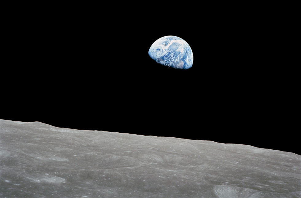 One of the most famous photograph of the Apollo era, the Earth appearing to rise above the Moon's limb, taken by the Apollo 8 crew on Dec. 24, 1968.