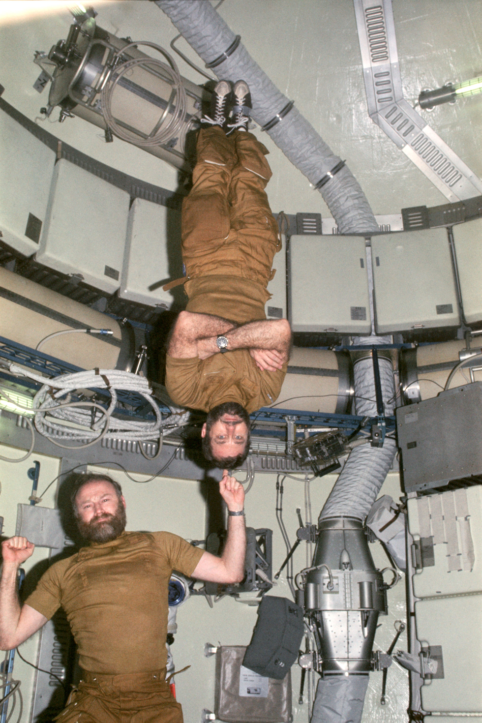 NASA astronauts Gerald Carr (left) and William Pogue demonstrate zero-g aboard Skylab. Image Credit: NASA