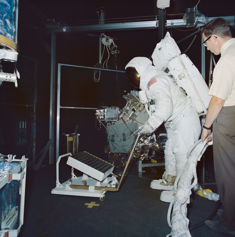 Buzz Aldrin practices setting up the laser retroreflector experiment, part of the EASEP suite of experiments. Image Credits: NASA