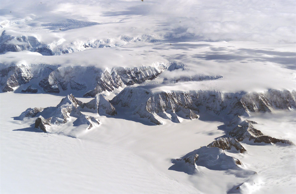 "The Larsen Ice Shelf in Antarctica as viewed from NASA's DC-8 aircraft. Antarctica is sometime called ""White Mars"" because of its desolation and extreme environment, where temperatures rarely get over zero degrees Fahrenheit and the sun disappears for four months of every year. Image Credit: NASA/Armstrong"