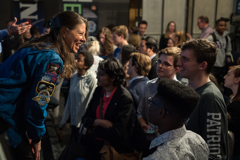 Caldwell Dyson, a NASA astronaut, continues the Future of Space conversation with students after the event. Image Credit: NASA