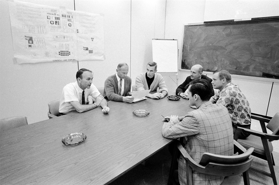 Apollo 10 and 11 astronauts (clockwise from left) Michael Collins, Buzz Aldrin, Gene Cernan, Thomas Stafford, Neil Armstrong and John Young meet to discuss the lessons learned from Apollo 10. Image Credit: NASA