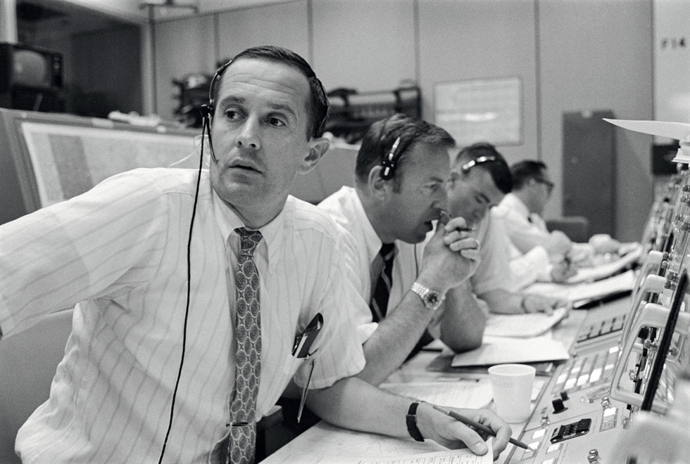 Spacecraft communicators are pictured as they keep in contact with the Apollo 11 astronauts during their lunar-landing mission on July 20, 1969. From left to right are astronauts Charles Duke, James Lovell and Fred Haise. Image Credit: NASA