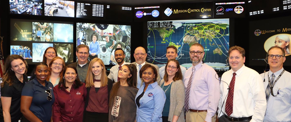 Wyche meeting Ariana Grande at a  tour of Johnson's Mission Control Center.