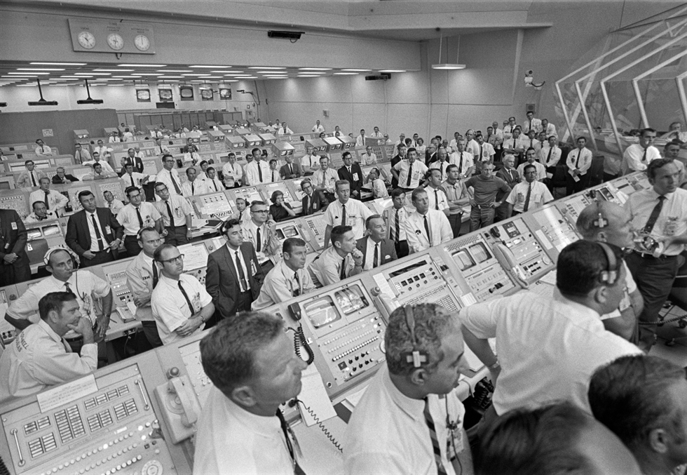 Engineers in the Firing Room at Kennedy watch the launch after Apollo 11 clears the launch tower. Image Credit: NASA