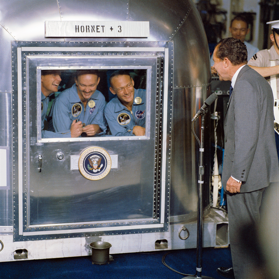 Close-up of President Nixon and astronauts (left to right) Neil Armstrong, Michael Collins and Buzz Aldrin in the MQF. Image Credit: NASA
