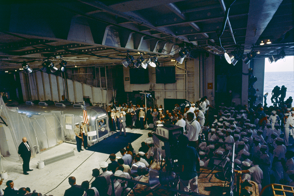 Overall view of Hornet's hangar bay, where President Richard Nixon welcomed home the Apollo 11 astronauts sealed inside the MQF. Image Credit: NASA