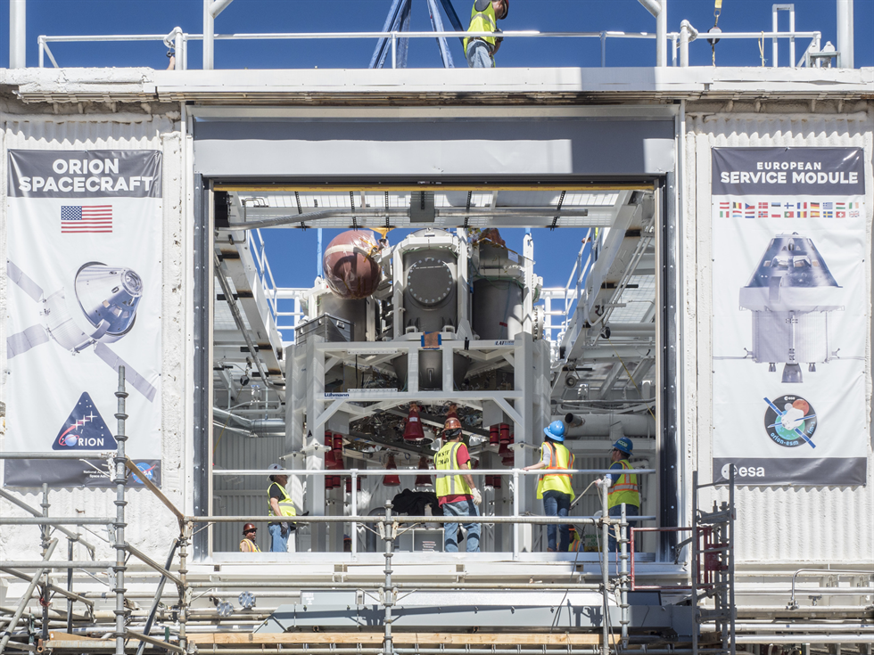 Engineers perform work at NASA's White Sand Test Facility ahead of testing of the Orion propulsion system.