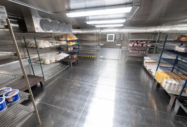 The kitchen expansion project included a new floor, plumbing under the building, walk-in cooler, updated kitchen equipment and more. Cosmetic changes to the eatery will come in October. Image Credit: NASA/James Blair