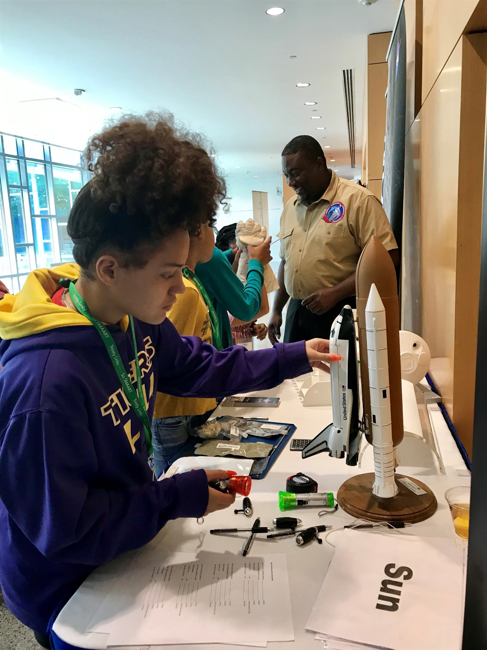 A combination of NASA exhibits and artifacts, along with an engaging hands-on learning activity, entranced the young learners who took part in the So SMAART program in late September. Image courtesy of Dr. Robert Howard.