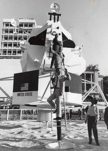Climbing on a mock-up of the Lunar Module in Bombay (now Mumbai), India, an estimated 1.5 million people greeted the astronauts in Bombay, the largest crowd of any city on the tour. Image courtesy of Michael Collins.