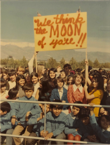 Crowds welcome the astronauts in Tehran, Iran; later they attended the Shah of Iran's birthday party. Image courtesy of Michael Collins.