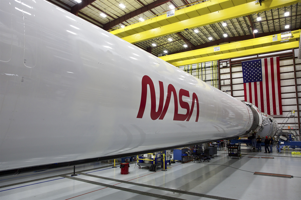 The worm logo returns on the Falcon 9 rocket that will be used to launch Crew Dragon.