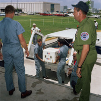 The first Apollo 11 sample return container, with lunar surface material inside, is unloaded at the Lunar Receiving Laboratory, Building 37, Manned Spacecraft Center (MSC). The rock box had arrived only minutes earlier at Ellington Air Force Base by air f