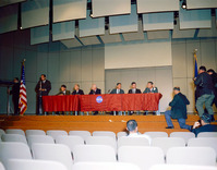 A press conference was held in the Building 1 Auditorium at the MSC to announce the first Gemini astronaut selections. L to R: Paul Haney (standing); Walter Schirra and Thomas Stafford; Dr. Robert Gilruth; Virgil Grissom and John Young; and Donald K. Slay